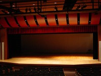 Image of empty stage looking from center of seats.