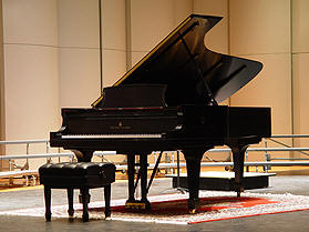 Image of Steinway Model D Concert Grand Piano on stage.