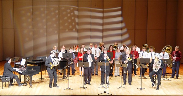 "Brass Players from Edgerton Middle School joins the Quintet on stage for  ""Stars and Stripes Forever"""